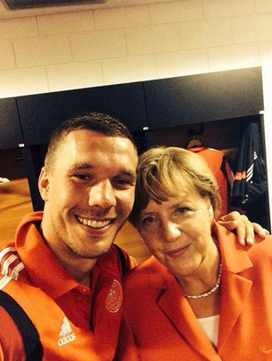 Angela Merkel com Lukas Podolski