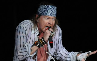 Axel Rose (R), lead singer for the band