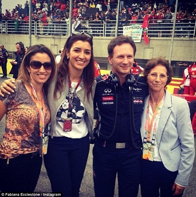 3697D4DC00000578-3708138-Flosi_left_and_her_mother_right_pose_alongside_Red_Bull_Team_Pri-m-4_1469513559917