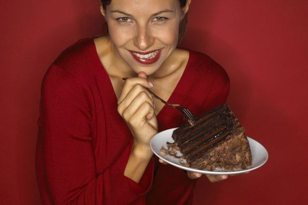 Woman eating a chocolate cake