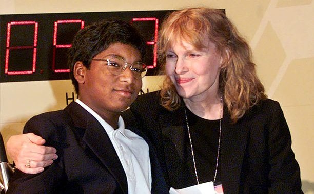 Actress Mia Farrow puts her arm around her adopted son Thaddeus as they participate in the global summit on polio eradication Wednesday, Sept. 27, 2000, at United Nations headquarters. Farrow, who suffered from the disease as a child, and her 12-year-old son who is paralyzed by it, joined U.N. Secretary General Kofi Annan in starting a clock to countdown the number of polio cases until 2005. (AP Photo/Richard Drew)