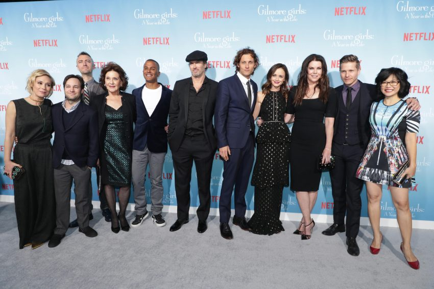 """Liza Weil, Danny Strong, Sean Gunn, Kelly Bishop, Yanic Truesdale, Scott Patterson, Tanc Sade, Alexis Bledel, Lauren Graham, Matt Czuchry and Keiko Agena seen at Netflix's """"Gilmore Girls: A Year in the Life"""" Premiere on Friday, November 18, 2016, in Los Angeles, CA. (Photo by Eric Charbonneau/Invision for Netflix/AP Images)"""
